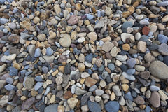 Textured pebbled beach background Stock Photography