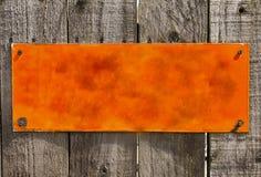 Textured pomarańczowy ośniedziały metalu tło, puste miejsce powierzchnia Zdjęcia Royalty Free