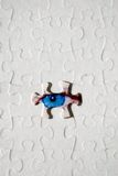 Textured Puzzle With Eye. A textured puzzle with an eye behind the missing piece.  (Looking for something, solving the puzzle Royalty Free Stock Photos