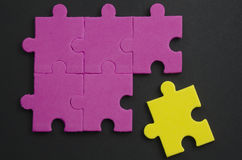 Tolerance. Textured puzzle pieces of different colors, representing tolerance Stock Photography