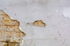 Textured ragged white wall plaster, after taking out tile. The wall have to be repaired with plaster stock photography