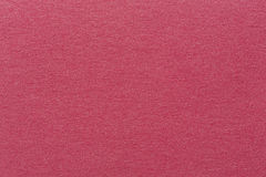 A textured red background with a subtle screen pattern. High quality texture in extremely high resolution Stock Image