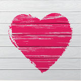 Textured red heart on wooden background. Royalty Free Stock Photo