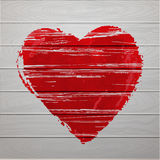Textured red heart on wooden background. Stock Photo