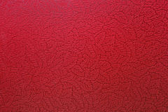 Textured red wall with oak leaves print. Background Royalty Free Stock Photos