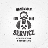 Textured Retro Handyman carpenter corporate service badge symbol Royalty Free Stock Photo