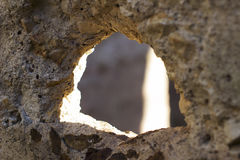 Textured rough hole in concrete Royalty Free Stock Photos