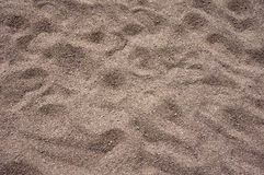 Textured sand. Abstract background of textured sand surface Royalty Free Stock Photos