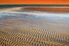 Textured sand in evening, the Baltic sea coast. Textured sand in evening,sun set, the Baltic sea coast Stock Photos