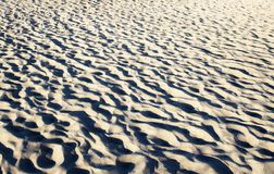 Textured sand in evening, the  sea coast. Textured sand in evening, the Baltic sea coast Royalty Free Stock Photography