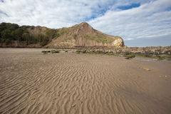 Textured sand and headlands at Cayton Bay Royalty Free Stock Photography