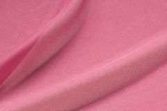 Textured shocking pink silk crepe fabric in folds Royalty Free Stock Images