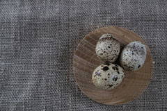 Textured spring background with small quail eggs. Eco products Stock Photos