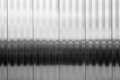 Textured stainless steel panel vertical pattern Royalty Free Stock Photo
