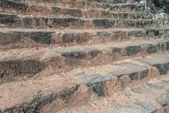 Textured stairs in old city in Sri lanka. Red earth on stair royalty free stock photography