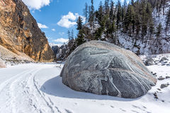 Textured stone on the frozen river Stock Photography