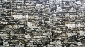 Textured stone wall. stock images
