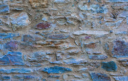 Textured stone wall pattern background Stock Images
