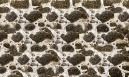 Textured stone walls built of large rough stones held together. By dark lumps of white cement limestone Royalty Free Stock Photos