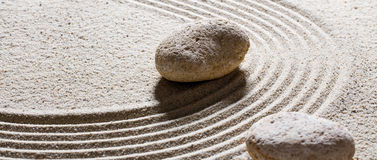 Textured stones on sand waves for suppleness and peace Royalty Free Stock Images