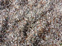 Stones and Shards of Glass of the Glass Beach in Fort Bragg, California. Textured Stones and Washed Out Shards of Glass on the Beach on Fort Bragg in California stock image