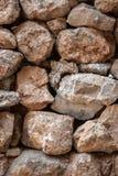 Textured stonework background. Ancient textured stonework background. Brown tint Stock Images