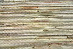 Textured straw background. Textured background of wooden and straw like material Royalty Free Stock Photo