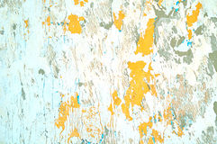Textured stucco background - light beige peeling stucco and bright orange peeling paint Royalty Free Stock Images
