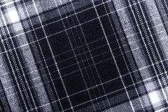 Textured surface of checkered cloth. Toned Stock Photo