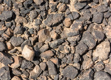 Textured surface of desert rocks Stock Photos