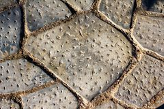 Textured surface, detail from old stone tile street. In Athens, Greece Stock Photography