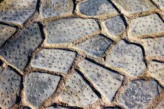 Textured surface, detail from old stone tile street. In Athens, Greece Royalty Free Stock Images