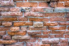 The textured surface of an old brick wall Stock Image