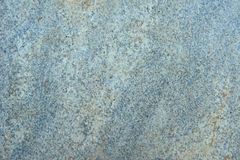Textured surface of polished granite stone in shades of grey. Commonly seen on kitchen counter tops Royalty Free Stock Photos