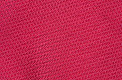 Textured synthetical background. Close up of red textured synthetical background Stock Photo