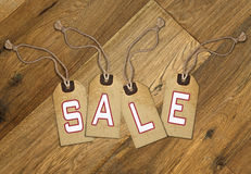 Textured tag with sale tied with brown string Stock Photography