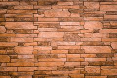 Textured texture of an old stone wall. Wallpaper for background and design. Textured texture of a light brown, old stone wall. Wallpaper for background and royalty free stock photos