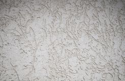 Textured textured gray uneven wall as a background with veins stock images