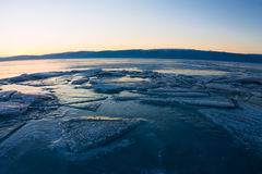 Textured tile blue ice hummock of Lake Baikal at sunset. Olkhon Stock Photography