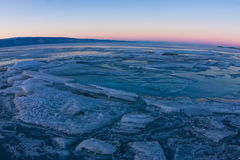 Textured tile blue ice hummock of Lake Baikal at sunset. Olkhon Stock Images