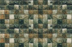 Textured mosaic of square elements of natural stone of dark color for bathrooms and swimming pools stock image