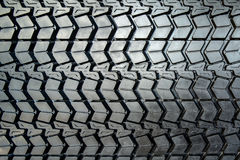 Textured tire tread. Photo coarse textured black tire tread large truck close-up Royalty Free Stock Photography