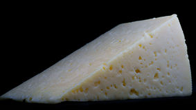 Textured triangle of cheese stock photo