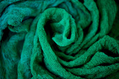 Textured, twisted into a flower gauze. Emerald green. Close Stock Images