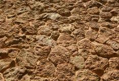 Textured uneven stone background. Textured umeven stone background close up, sand color Stock Photography