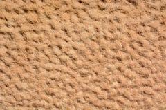 Textured uneven stone background. Textured umeven stone background, sand color tone Royalty Free Stock Photo