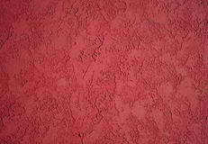 Textured red paint. Textured vibrant red paint background Stock Photos