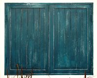Textured of vintage colorful dark blue green painted wood home w. Isolated textured of vintage colorful dark blue green painted wood home window with grass Royalty Free Stock Photo