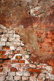 Textured wall with brick and stucco Stock Images