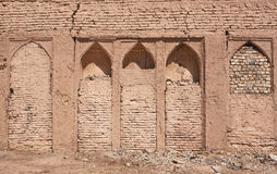 Textured wall with bricked-up niches in house of the Middle East Stock Images